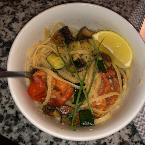 Linguine noodles with zucchini, tomatoes, and mushrooms