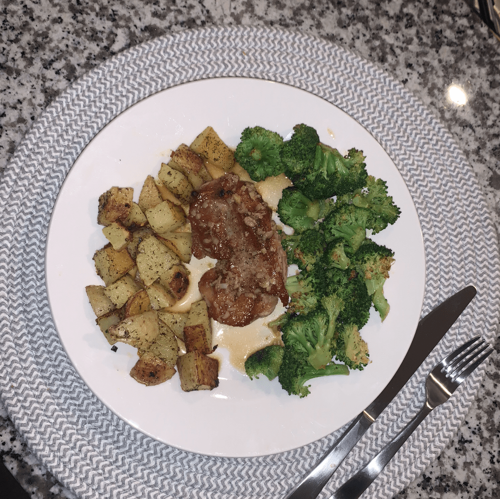 honey glazed pork chop with oven roasted broccoli and potatoes